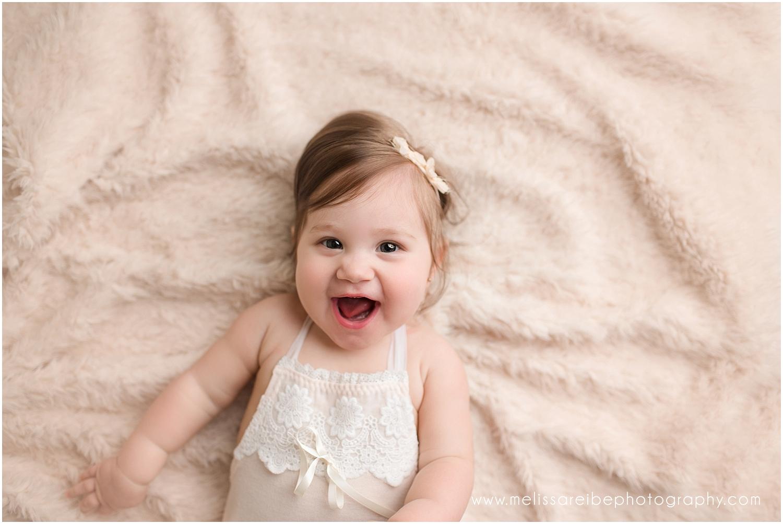 Baby on cream soft rug
